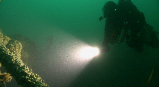 Underwater diver exploring the wreck of the Mendi 2